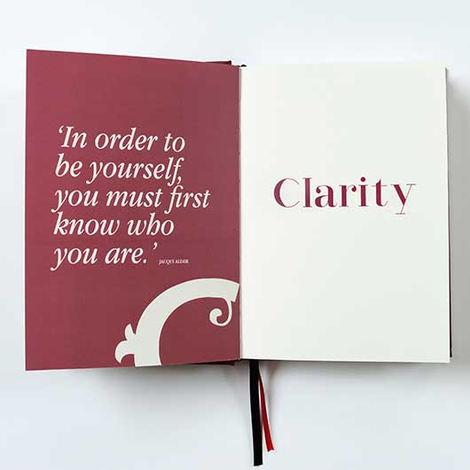 Burgundy page with quote 'In order to be yourself you must first know who you are.' with the word Clarity printed in burgundy on the opposite page showing a look in side Clarity Simplicity Success A Self Coaching Journal for Women