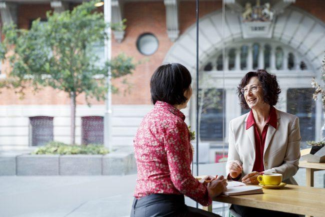 Jacqui Alder talking with a female client