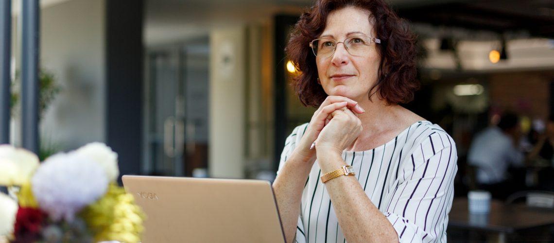 Jacqui Alder at her laptop