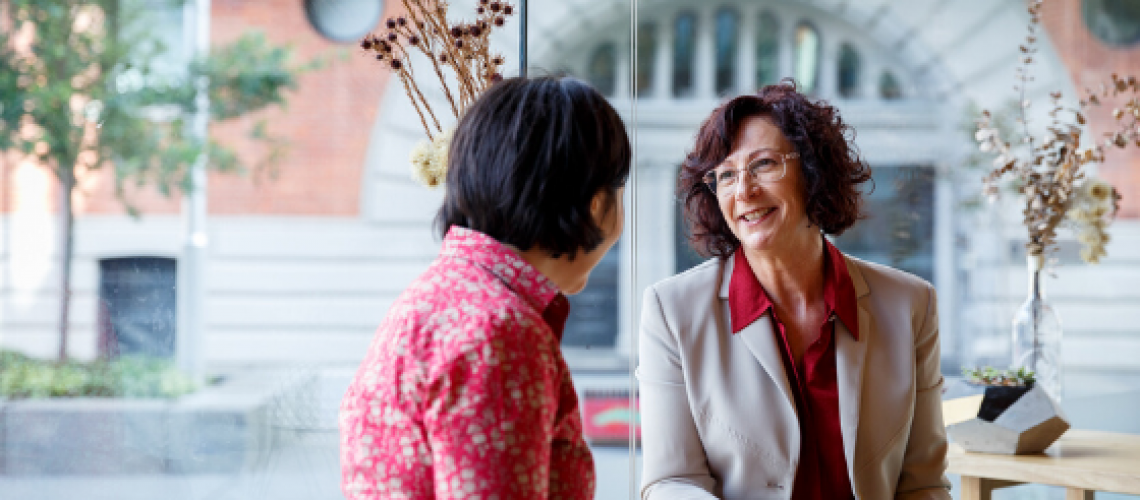 Jacqui Alder, speaking with a female client